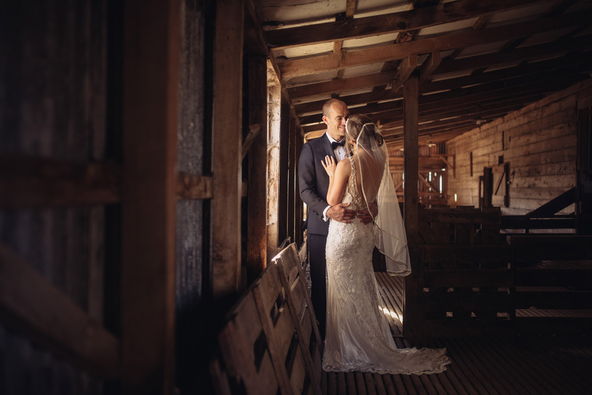 Photograph of wedding couple in barn in family farm, New Zealand